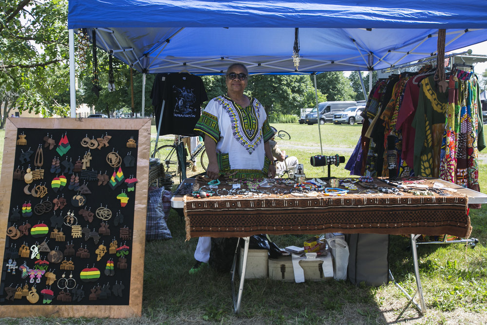 Gail Lucas, Dawn-Berry Walker's cousin, exhibits and sells traditional clothes and jewelry at the festival.
