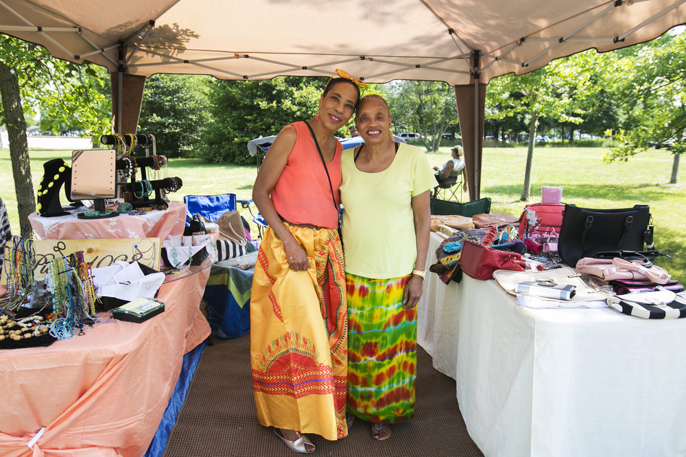 Penny White and her sister Cecelia Lawson sell products at the festival.