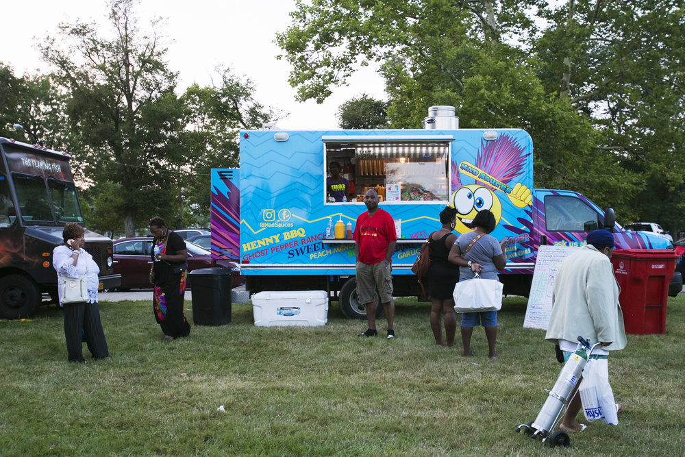 People order food at Mad Sauces food truck.