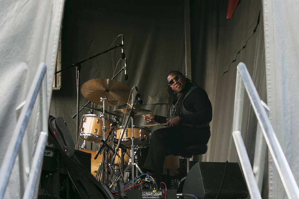 Drums player Jamison Ross performs on the stage.