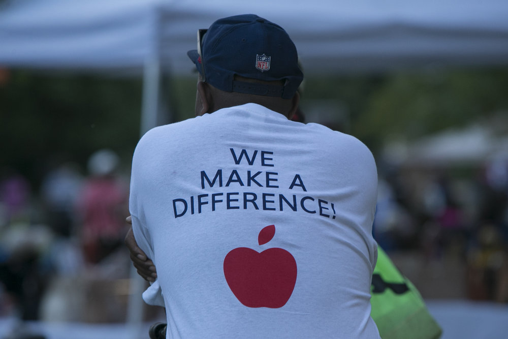 Robert Brown wears a shirt with a sign saying We Make A Difference.