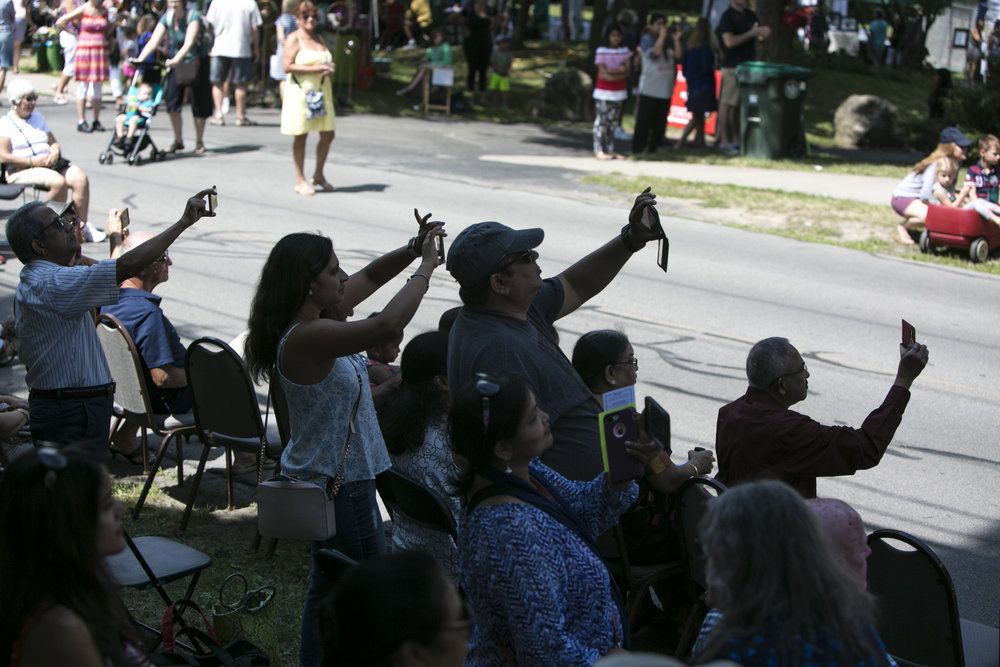 Visitors to the Glen Park Art Festival make recordings of the performances.
