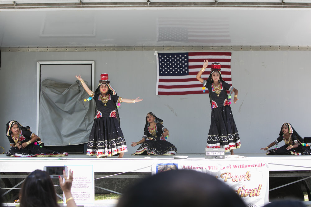 Young dancers from Jhankaar, a locally owned Bollywood dance studio, perform on the festival stage.