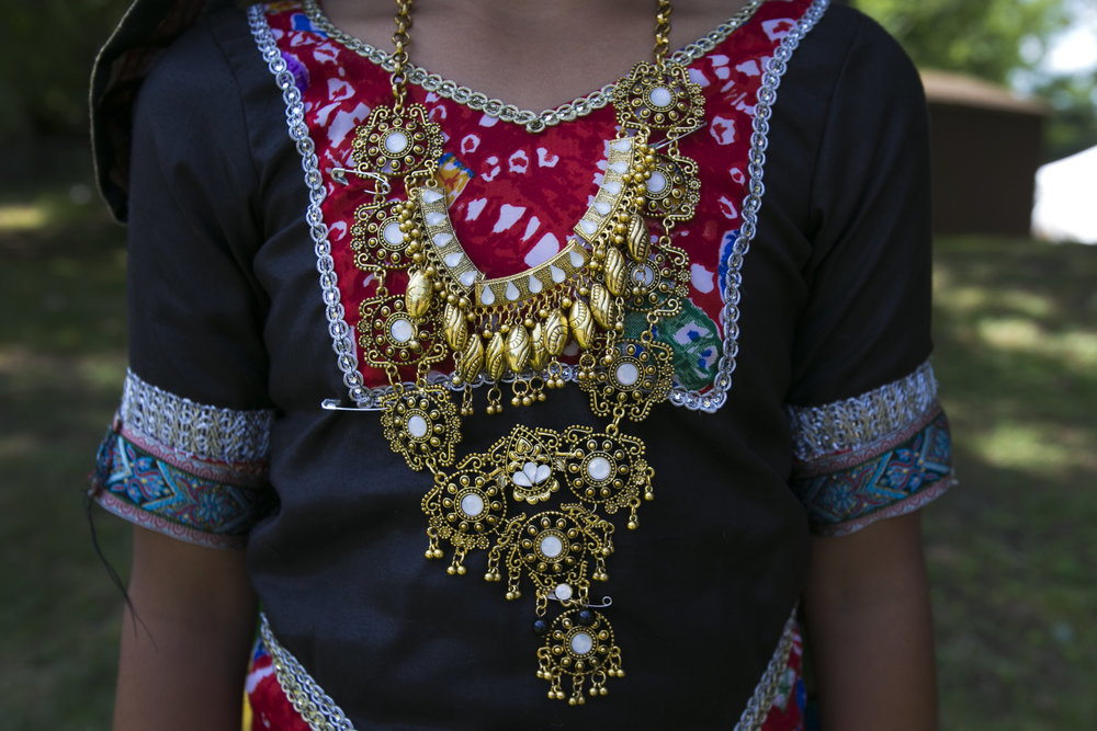 Dancers wear traditional Indian necklaces.
