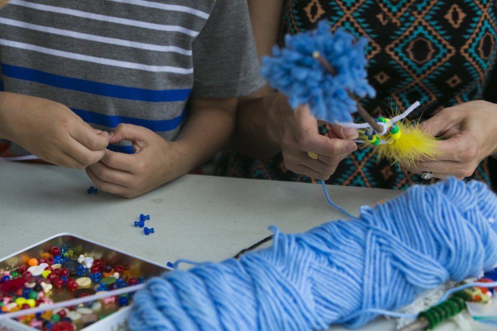 Alison Busch and her 4-year-old son Oliver Busch make crafts together.
