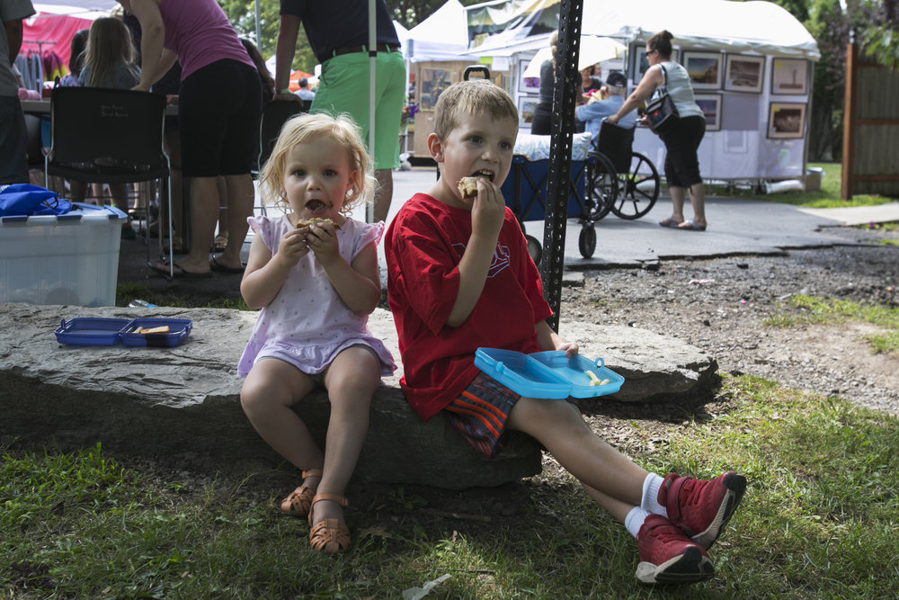 Brayden Sonnenberger, 5, has lunch with his 2-year-old younger sister Cassidy.