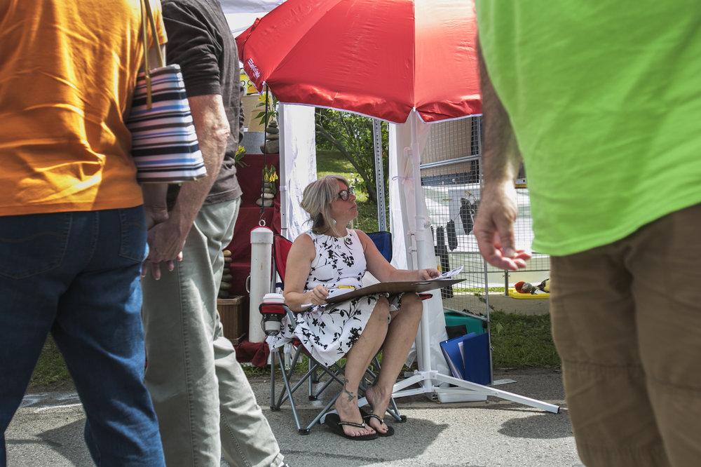 Nikki Milley, an artist from Wilson, displays her work.