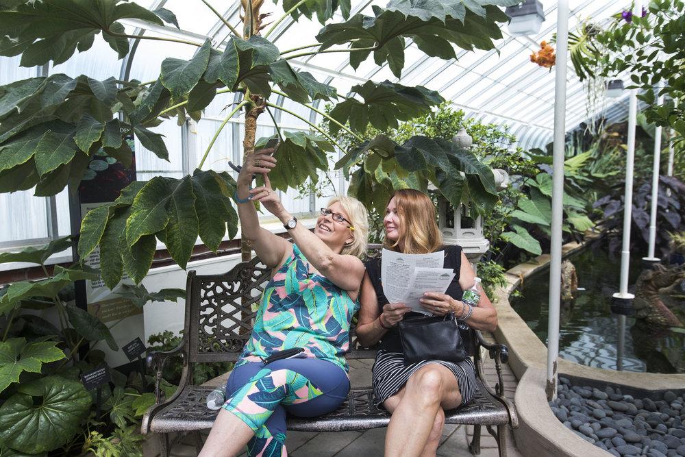 Debra Meyers-Murray and Gloria Busman take selfies.