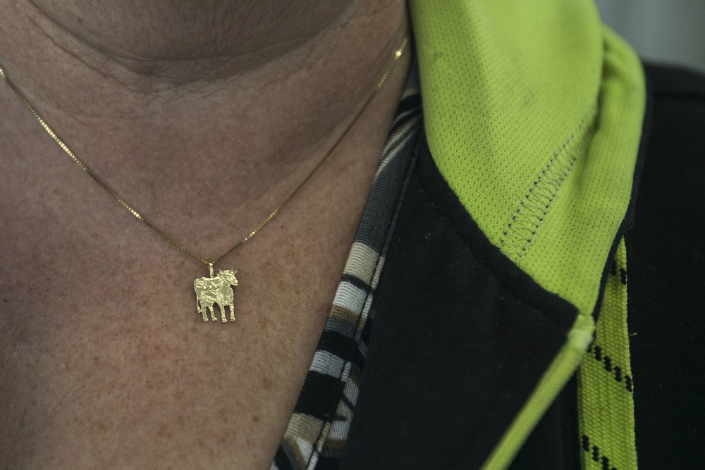 Brookly's grandmother, Barbara Rader, wears a cow pendant necklace to show her support.
