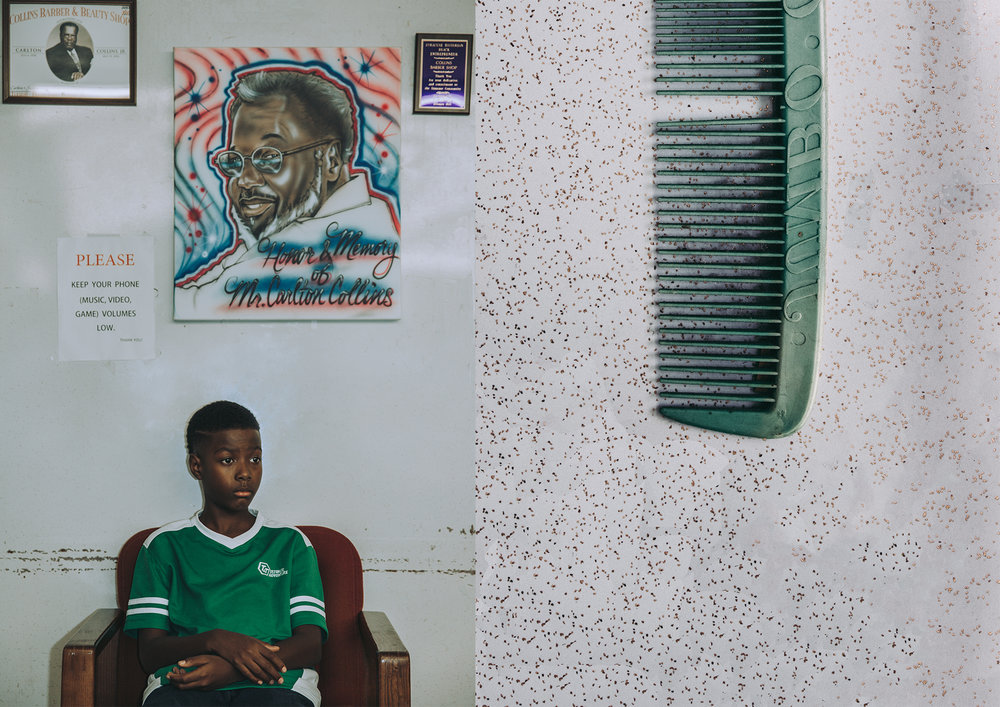 LEFT: Ga'verri Jones-Collins, 10, Charleston's oldest grandson, sits for a portrait in front of an air-brush painting of his great grandfather. RIGHT: A comb Carlton and Juanita purchased in South of The Border, South Carolina, while traveling.