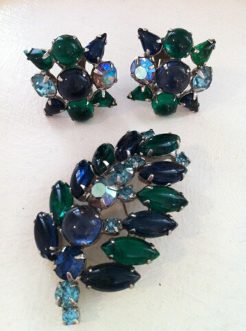 I have owned this beautiful jeweled Weiss blue and green leaf pin and matching earrings since the late 1950s.  I wore them with a soft blue wool dress that I made.
