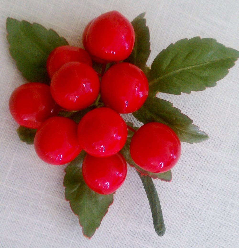 I wore this pin of cherries often in spring and summer from the 1950s and I still love it.