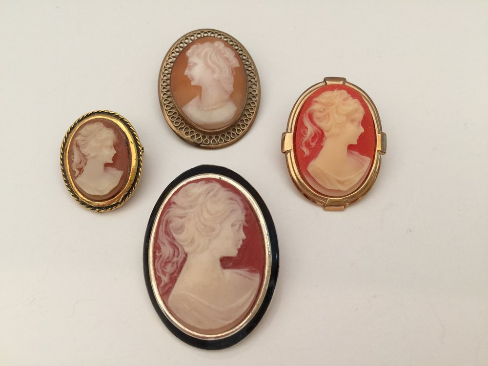 I have always loved cameos.  The pin at the top is the oldest; it is a Winard brand pin that is 12 K gold filled.