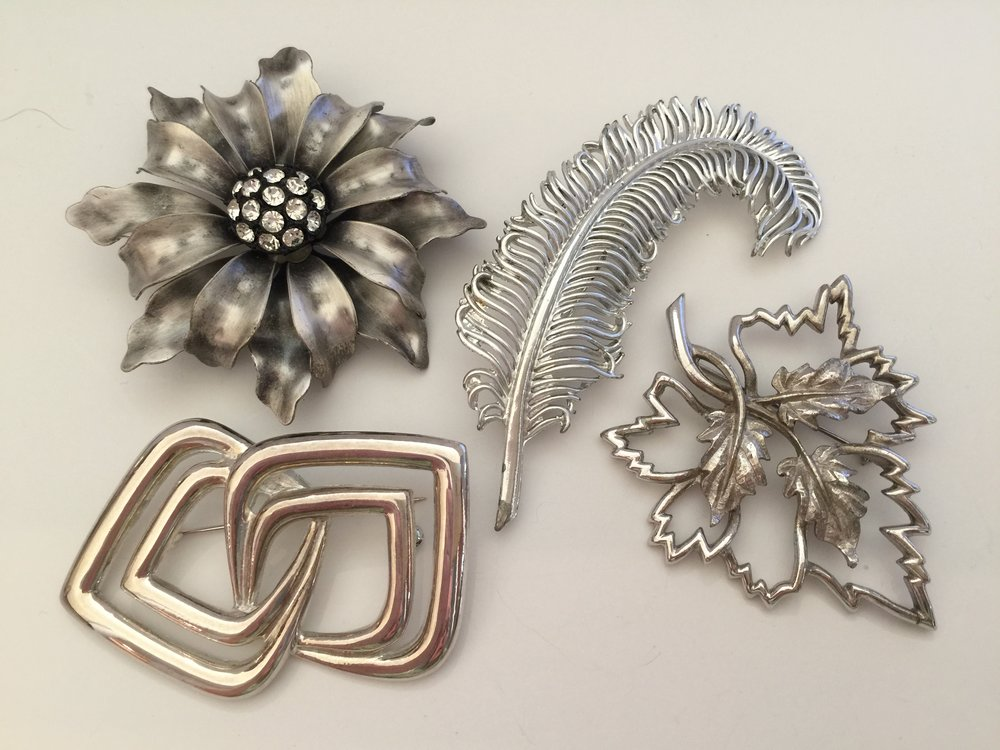 Silver pins ... the feather is a Coro pin and the leaf is an Emmons about 1960