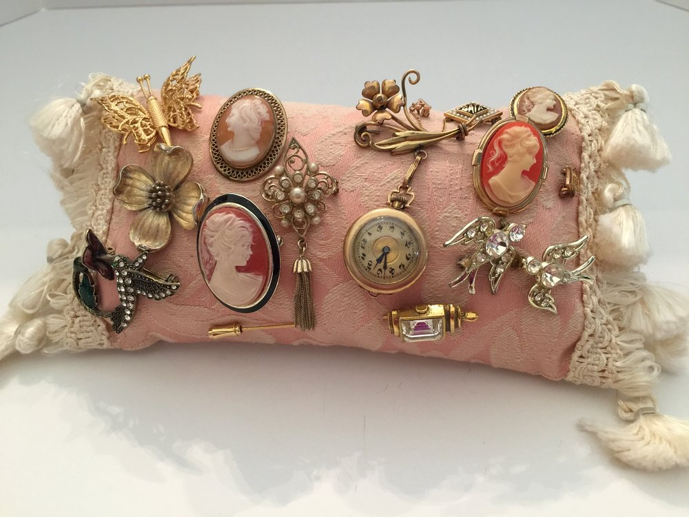 I have this little pillow with some of my favorite small pins in my bedroom. I like to enjoy seeing them every day ... like art.