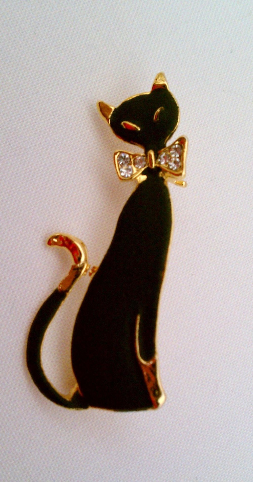 Black cat pin that belonged to my mother and now belongs to one of her granddaughters.