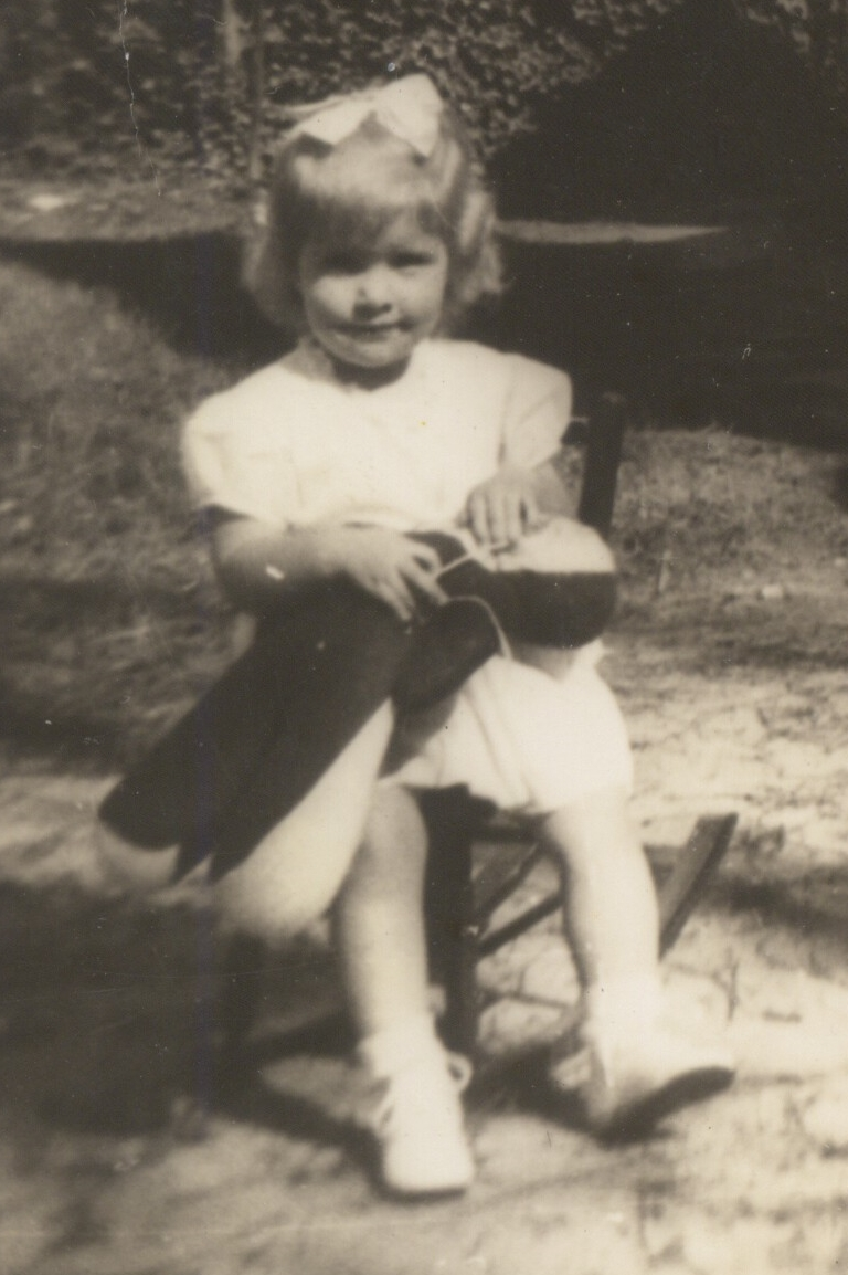 Here I am with my red rag doll in 1945.