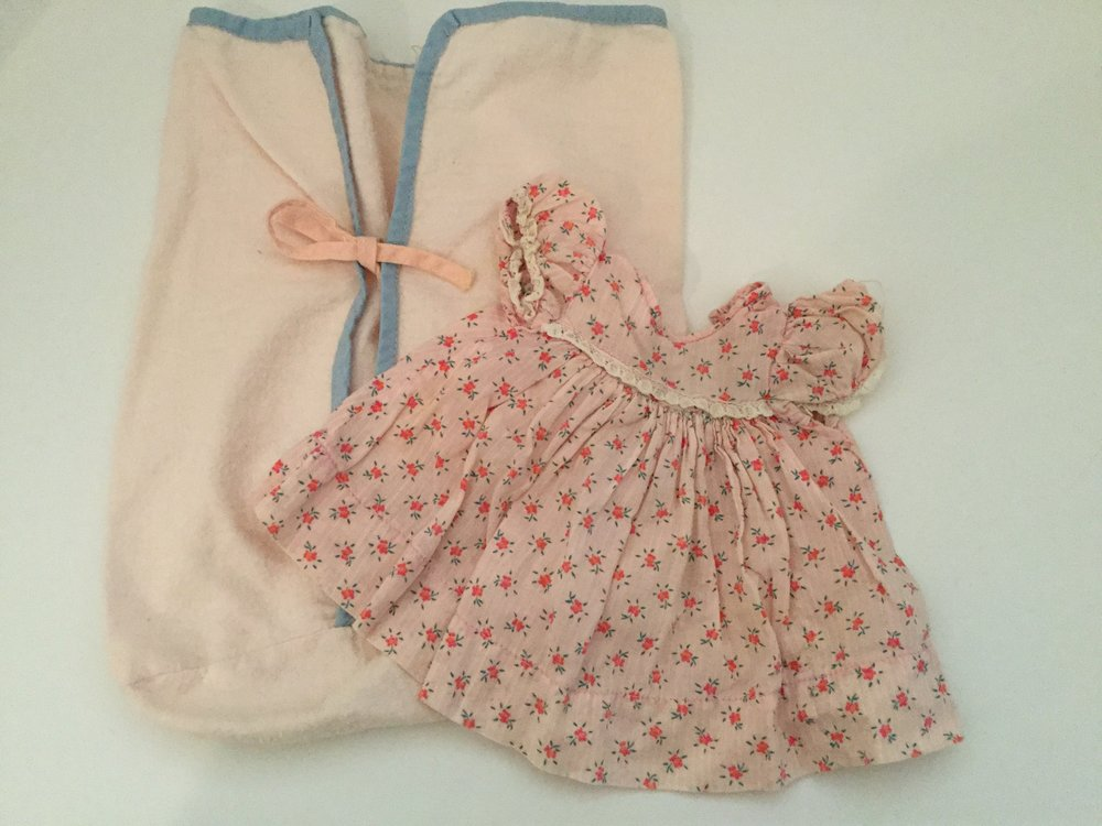 Pink bunting and dress my mother made for my small Tiny Tears doll