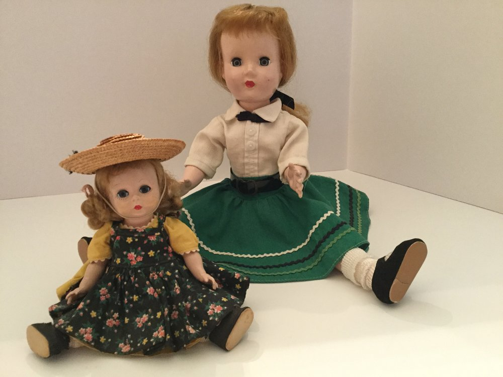 "My 1952 14"" Effanbee Honey walker doll ... typical 1950s circular skirt with rick rack. My 1953 8"" Madame Alexander-kin Wendy doll."