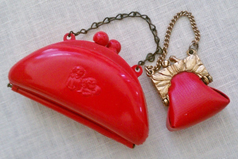Two red doll purses