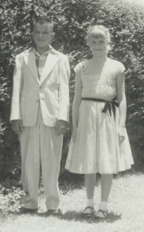 My cousin Jerry and I in 1954 ... I am wearing the pale aqua smocked Easter dress that I loved so much, complete with Easter shoes ... I was eleven years old
