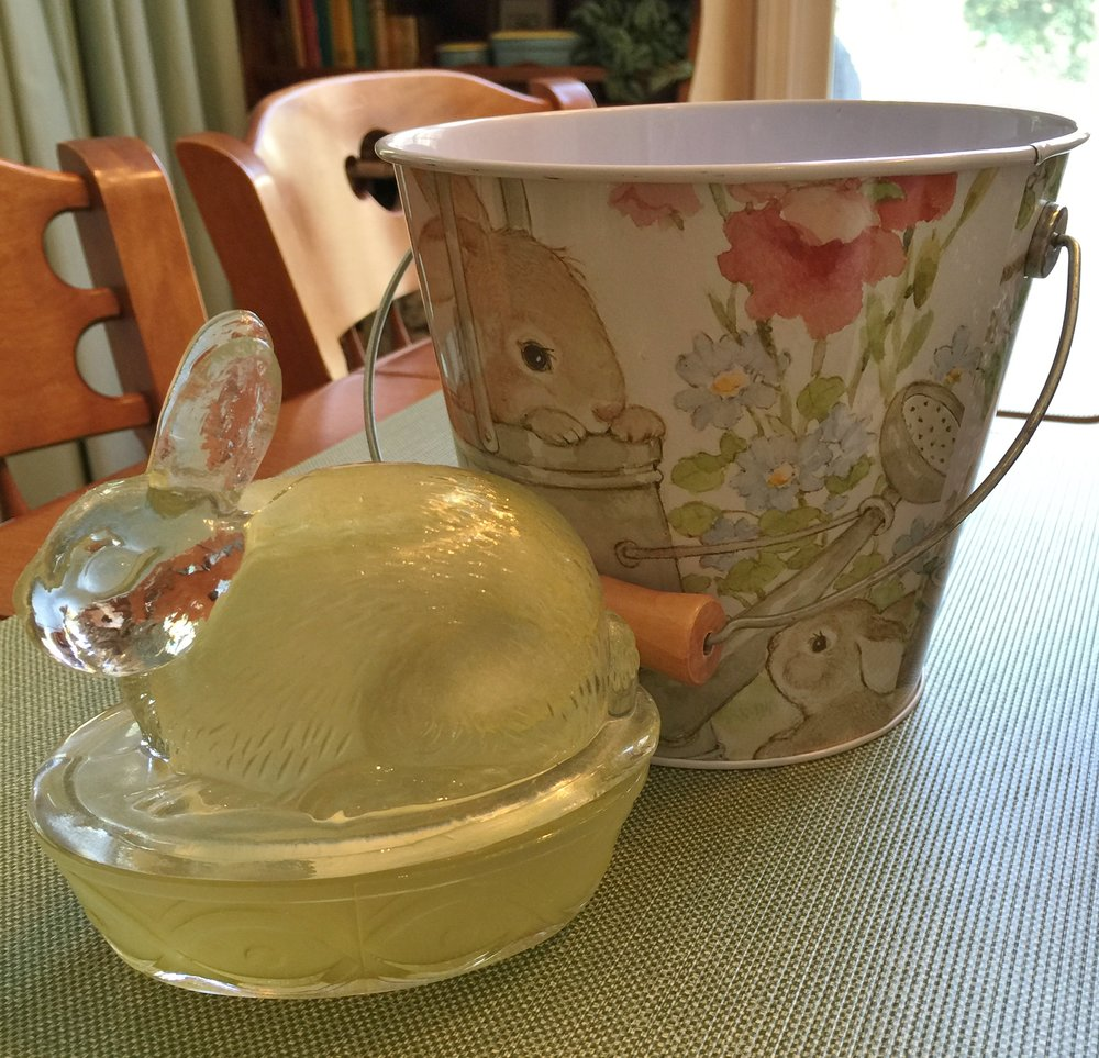 A really cute tin bucket that I found about ten years ago and a yellow bunny dish