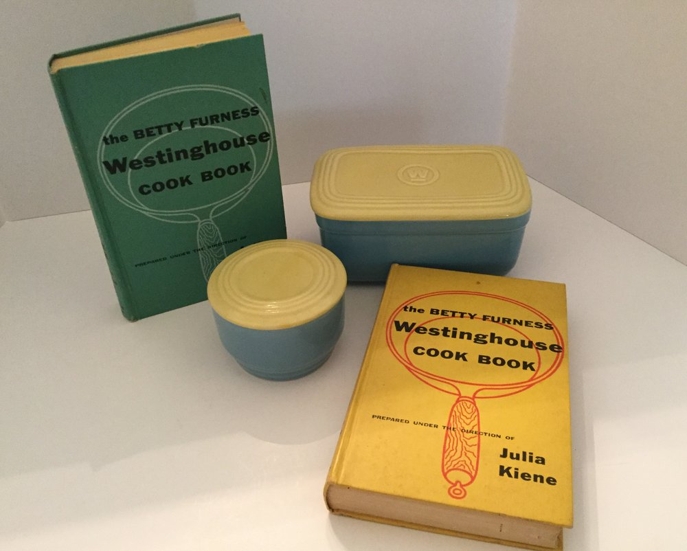 My two collected Betty Furness Westinghouse cookbooks ... amazingly my mother did not have one of these cookbooks.  The books were printed in 1954 and both are first editions.  Also pictured are two blue and yellow Westinghouse refrigerator dishes that came with the purchase of a refrigerator.  These were collected.