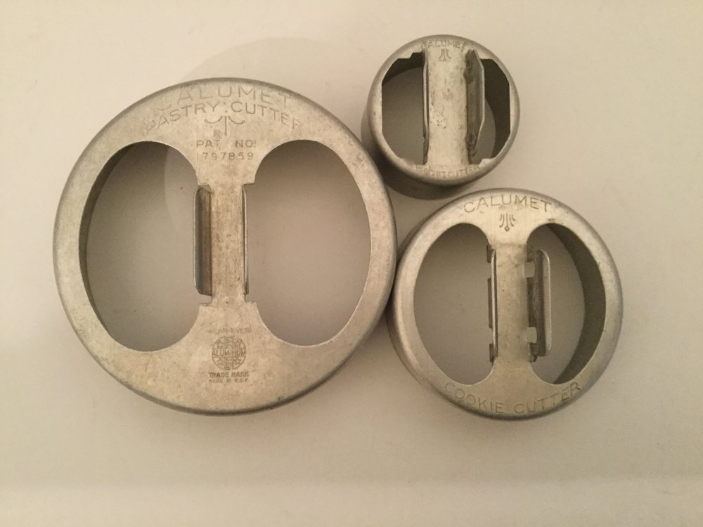 The three Calumet cookie cutters ... large cutter is a pastry cutter, the middle cutter is a cookie cutter, and the small cutter says biscuit cutter.
