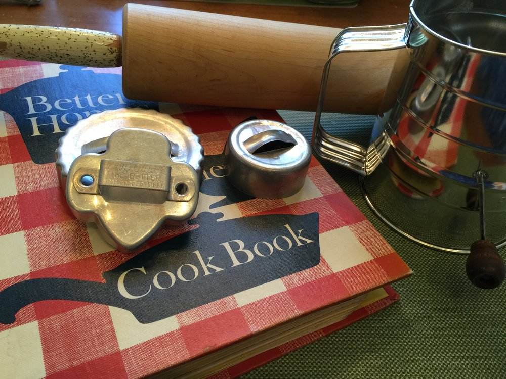 My own cookie making equipment ... 1964 edition of the famous red and white checked Better Homes and Gardens cookbook, sifter, rolling pin and cookie and biscuit cutters.  These have been mine for more than fifty years ... hard to think of my own things being VINTAGE!
