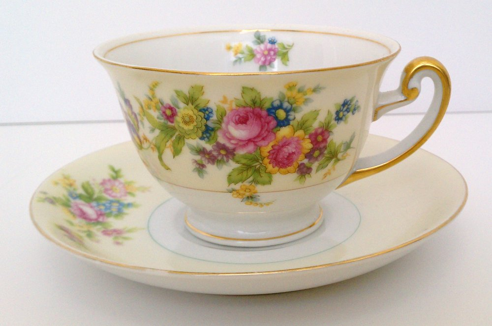 Pale yellow and white with pink and blue floral motif ... F&B (Meito) China ... made in Japan