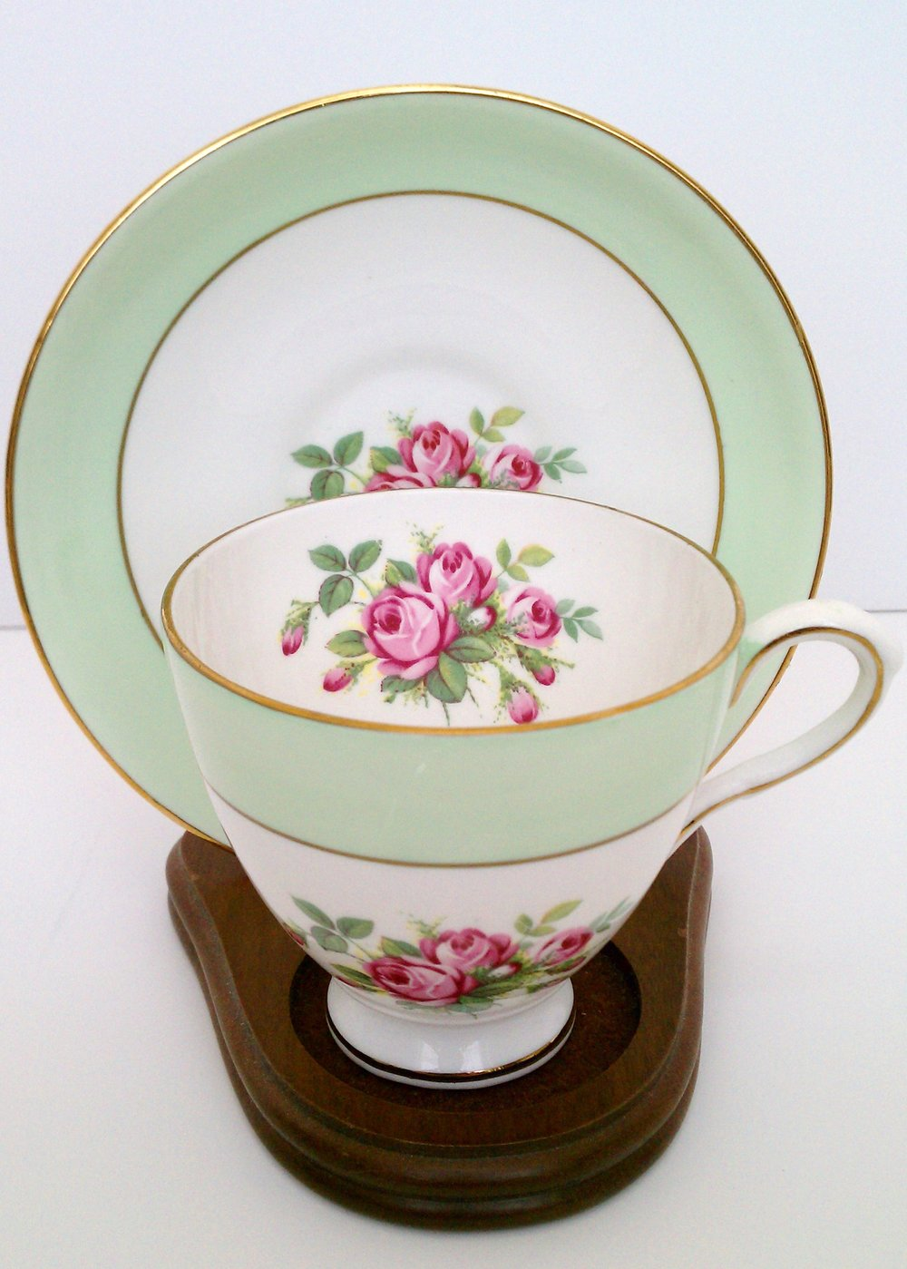 Green and white cup and saucer with pink rose motif ... Royal Taunton bone china made in England