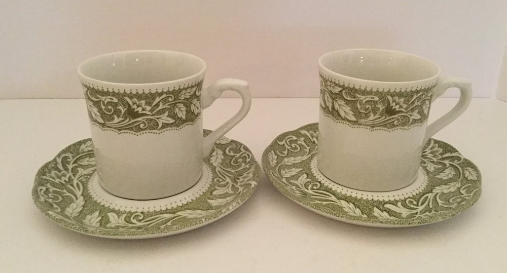 Two Sterling Renaissance cups and saucers made in England by J.G. Meakin