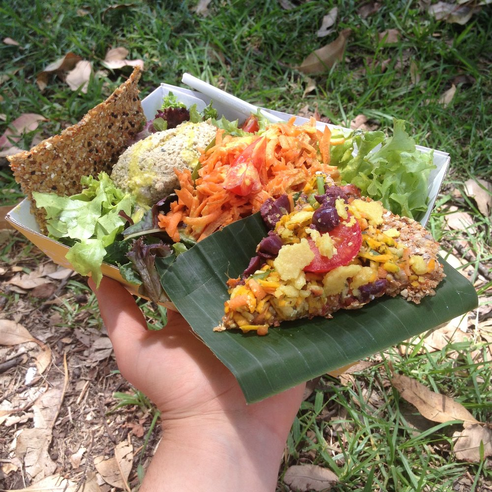 A raw, vegan pizza and salad from the Byron Bay Artisan Markets