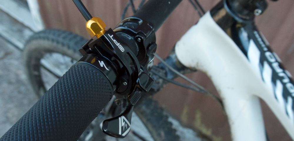 The OPT handlebar switch sitting above my dropper post thumb lever.