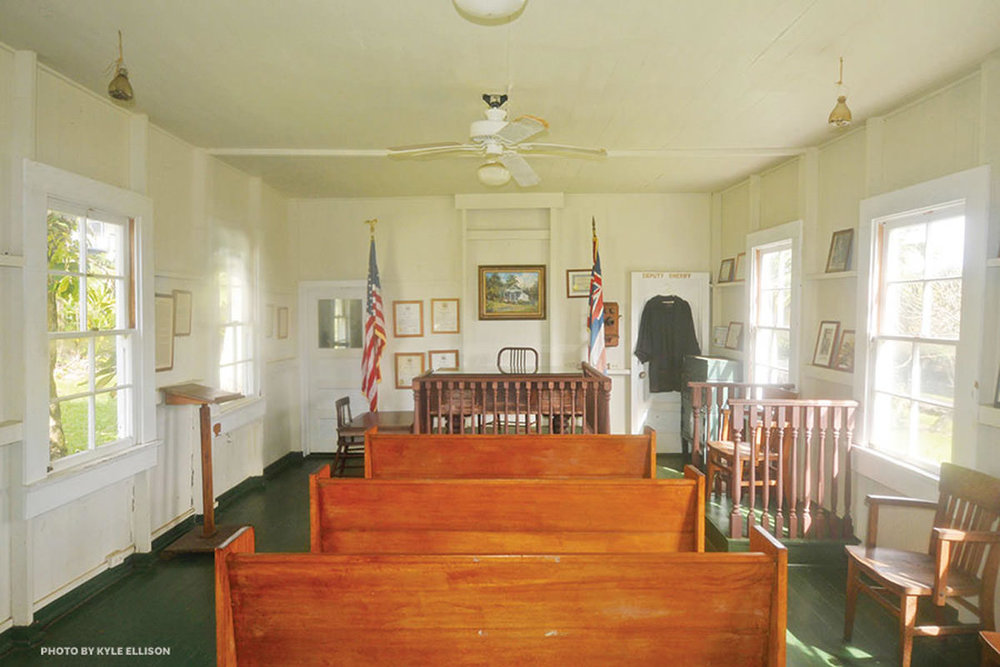 Hana Courthouse   When I'm asked whether I'll need a public defender, I'm standing in the shade of a plumeria tree, surrounded by clusters of flowers.…  read more