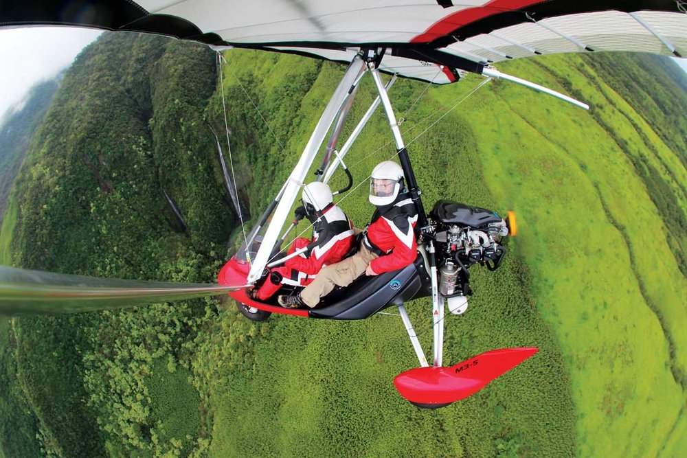 Hang Glide Maui   When I first catch sight of Armin Engert outside his hangar in Hana, he's wheeling a Radio Flyer wagon—and it's filled with three jugs of gasoline …  read more