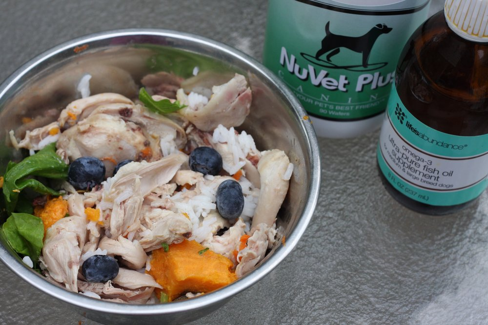Chicken, Rice, Spinach, Sweet Potato and a few Blueberries.  One NuVet Plus a day and a few drops of Life's Abundance Fish Oil for Omega-3.  We will be a supplier of both NuVet and Life's Abundance products in a few months! Stay tuned for any of your pet needs.