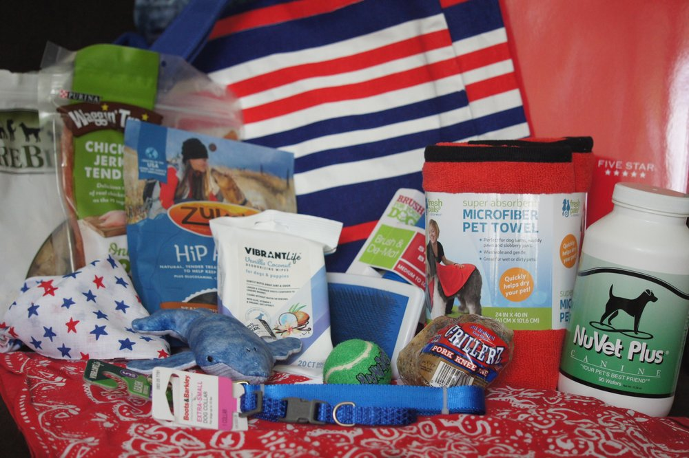 A sample of some of the things that may be included in your puppy starter kit.  Samples of NuVet Plus, treat and a small sack of food are also included.