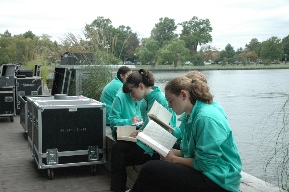 Concert Chorus members enjoy some quiet time outside before the performance