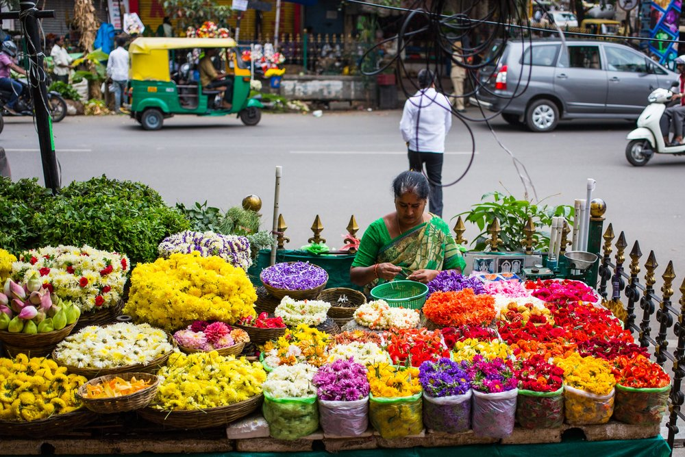 Bengaluru is famous for its flower stalls. Picture credit - Devesh Uba (above), Andreas Berg (below)
