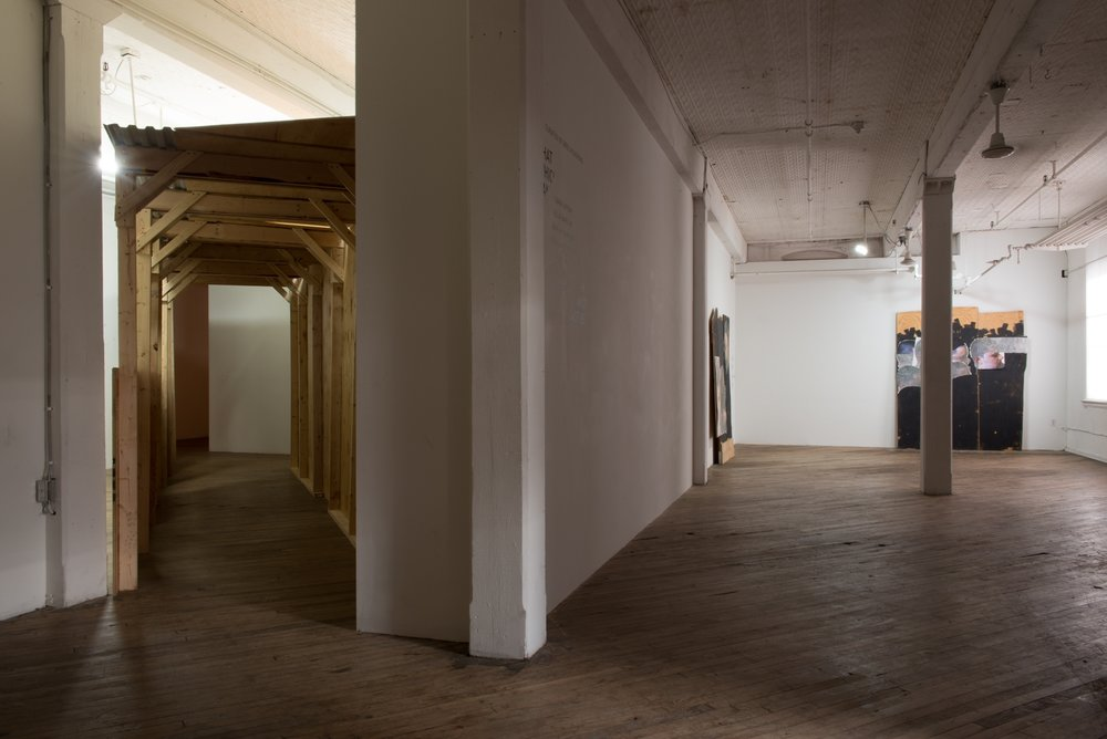 Installation view of  That Which Cannot Not Be  at Vox. Shotgun Inversion is on the left & two of Wilson's stapled pieces can be seen on the right. Image courtesy the artist and CONNERSMITH. Photo: Julia Staples.