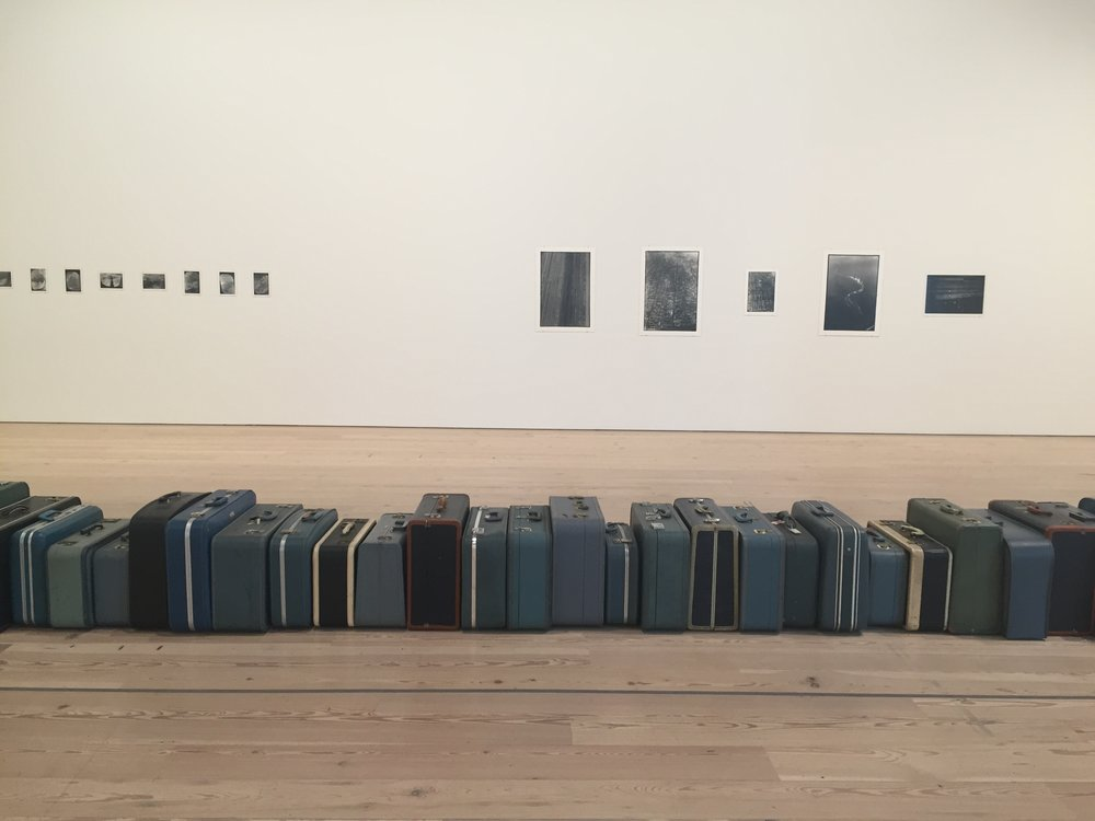 Partial view of Zoe Leonard's  1961  (2002–ongoing) at the Whitney. Leonard adds a secondhand suitcase to the sculpture for each year of her life that passes.