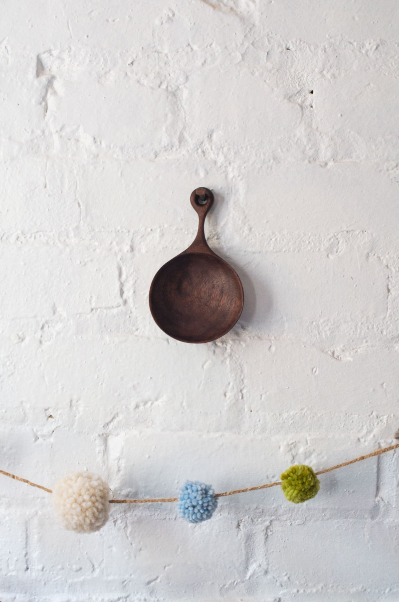 hanging scoop and pom poms