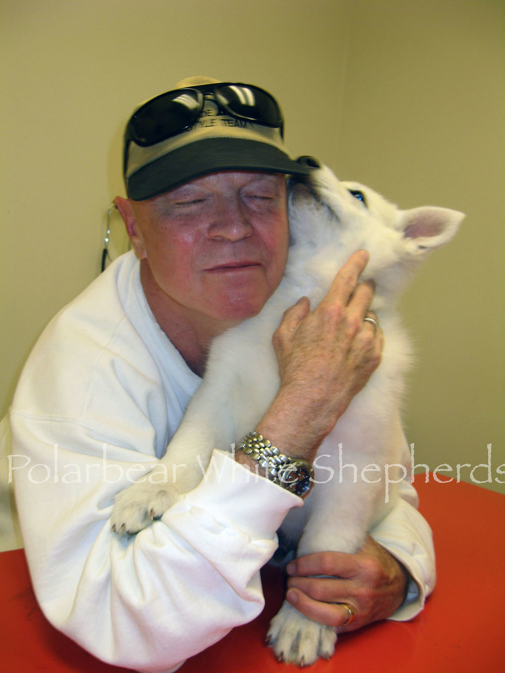A new owner at his puppy's first well puppy check here at Polarbear Land.