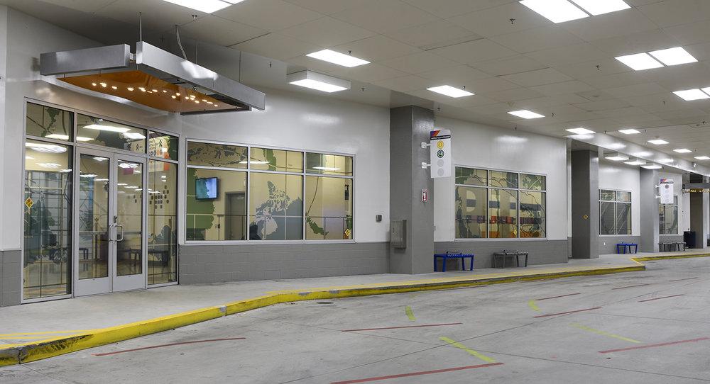 """""""The Commute: Idaho: Imports & Exports"""" vinyl on windows, Valley Regional Transit Station, Boise, Idaho, 2018"""