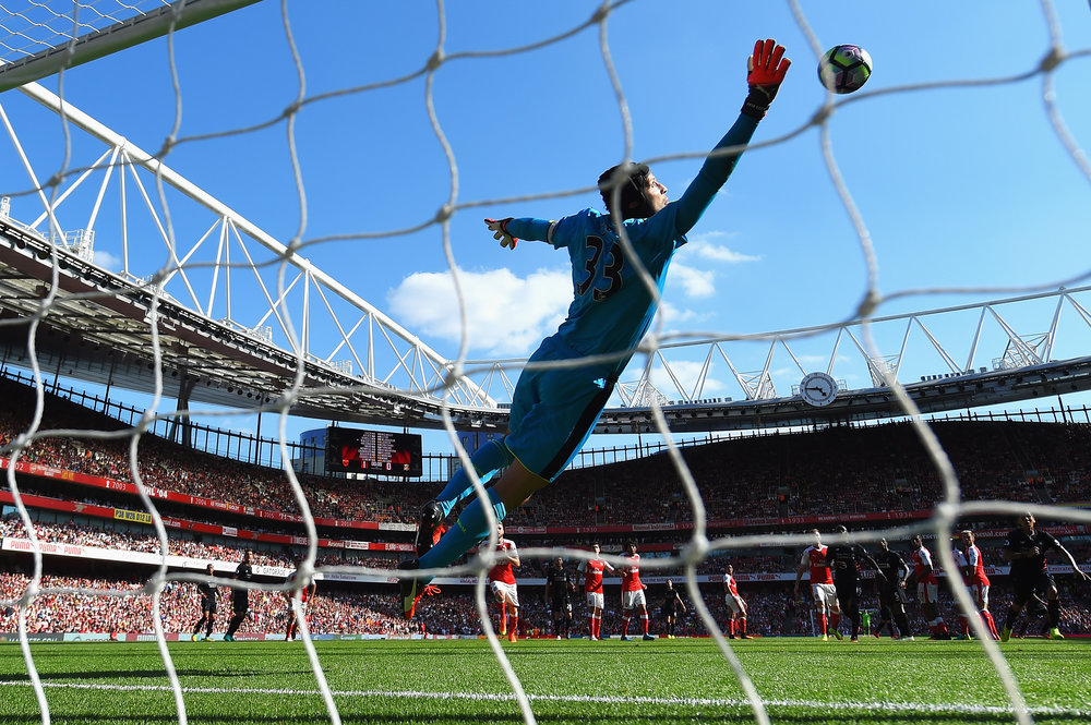 Matchweek 1: Arsenal 3-4 Liverpool. Petr Cech is unable to keep out a stunning Philippe Coutinho free-kick. Photo: Getty Images