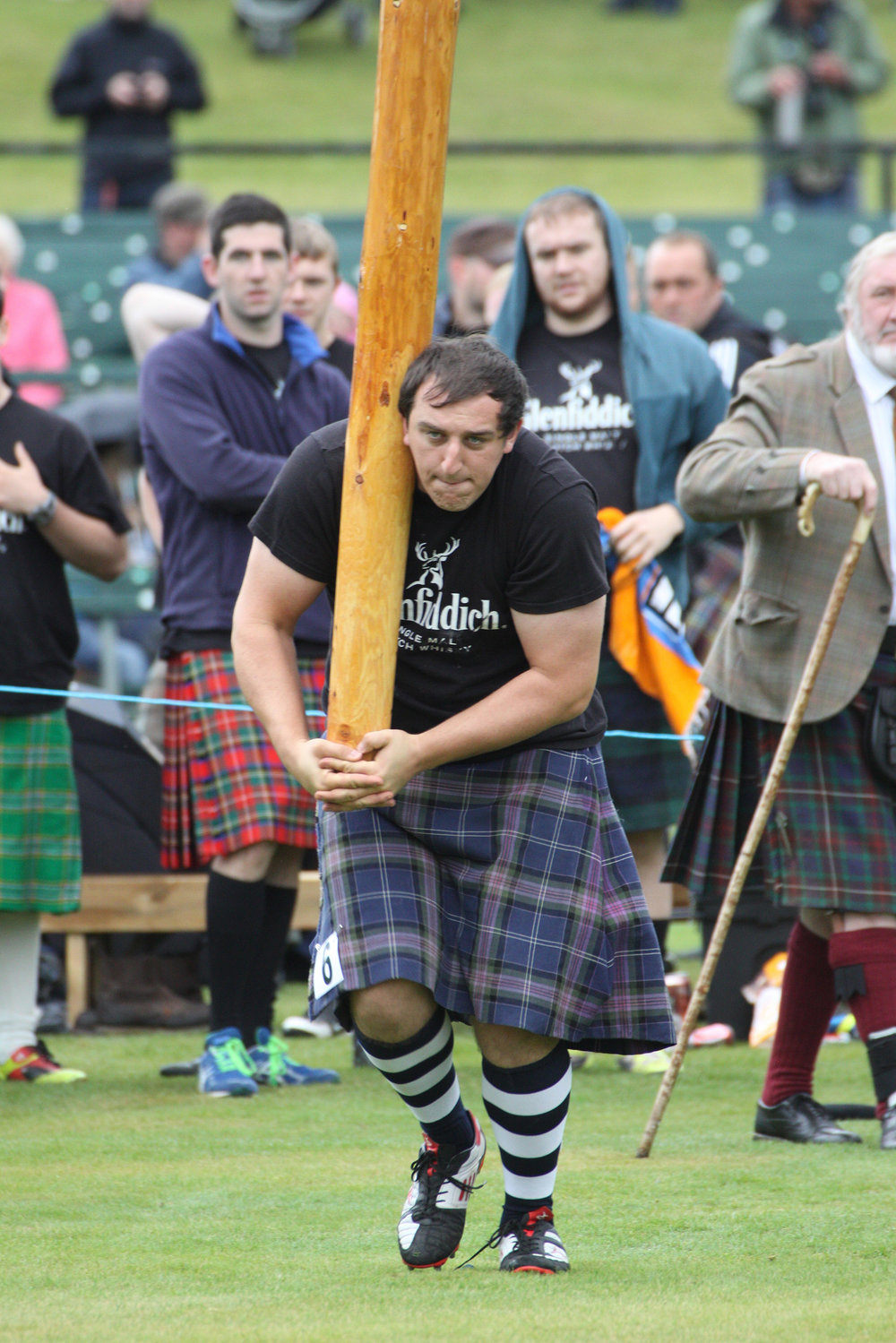 (Top) The Caber Toss at The Braemar Gathering. Photo from: The Braemar Gathering (Left) Throwing the hammer at The Braemar Gathering.