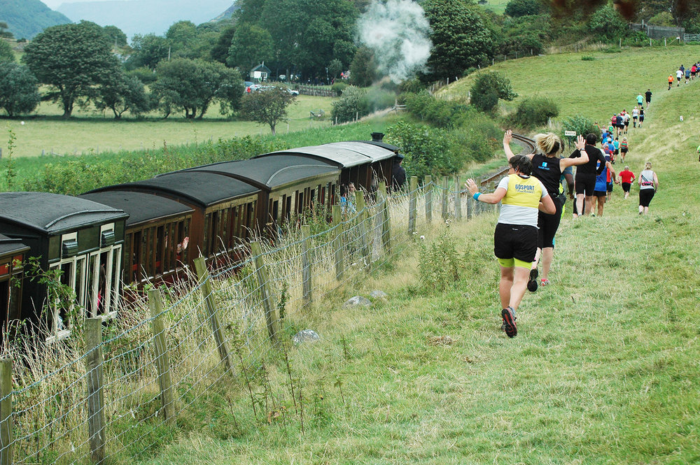 Runners race the Talyllyn Railway in Wales. Photo by: Doris O'Keefe