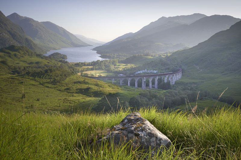 The stunning Scottish scenery provides the perfect background for the Hogwarts Express