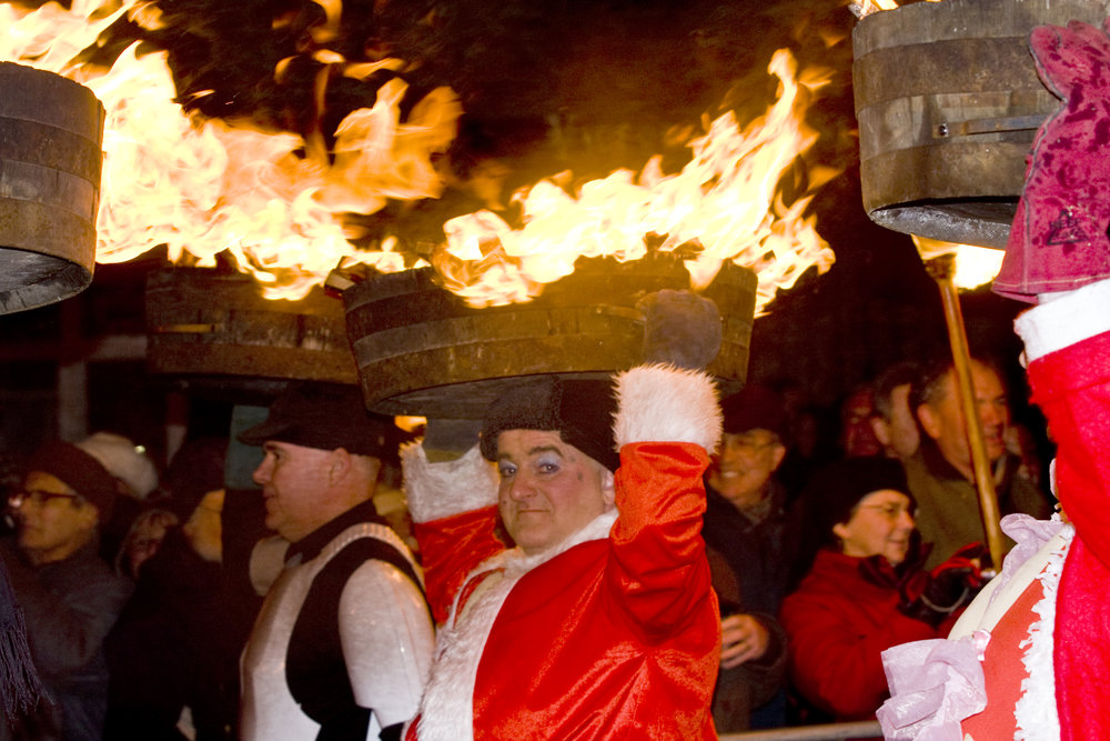 Guisers carry flaming barrels through Allendale. Photo by: R. Beedle